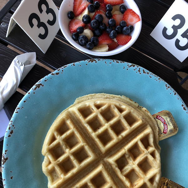 I like to start plain and work my way up... a delicious GF waffle with a side of fruit!