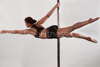 Photo: Vertical Pole Gymnastics - Parallel to the Floor with Scissor Extension