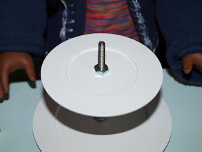 Photo: Add the smaller plate and the last nut.