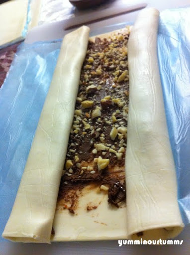 Half rolled puff pastry with nutella and hazelnuts