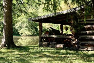 Photo: The historic Pfarr Log House overlooks a small lake