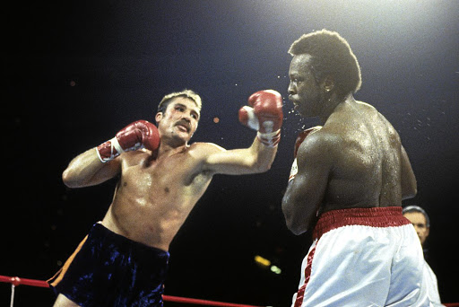 Gerrie Coetzee hooks  Michael Dokes during their fight in  Ohio, US.  Coetzee stunned the Americans to win the WBA World heavyweight title. The SA legend had 21 KOs in 33 wins against six losses and a draw.