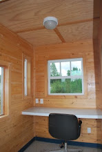 Photo: Inside a fully insulated Tiny House with a desk.