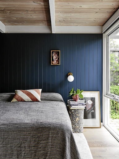 This bedroom wall gets a fresh and modern look with blue panelling.