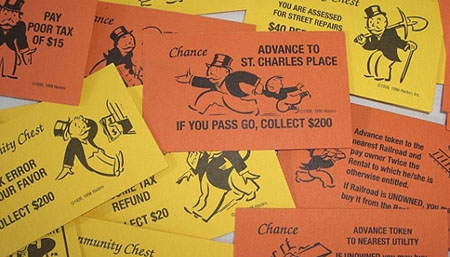"A pile of ""Chance"" and ""Community Chest"" cards from the board game Monopoly."