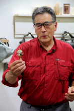 Photo: Clif shows some examples of his ornaments, ...