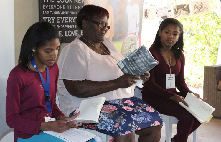 Reading poetry at the McGregor Poetry Festival last year are, from left, Shenesia Booysen, 16, Margaret Armoed, 58, and Anastacia Williams, 16, all from Helenvale