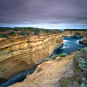 Oblivion by Jason Asher - Landscapes Waterscapes ( water, port campbell, great ocean road, cliffs, arch, grass, waterscape, oblivion, monoliths, sea, rock, ocean, wide, seascape, 12 apostles, national park and 12 apostles national park, big stopper, mutton bird island, long exposure, victoria, rocks )