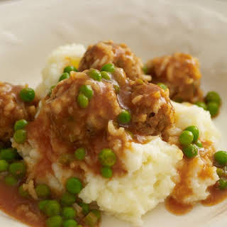Meatballs in Tomato and Pea Sauce with Mashed Potatoes.