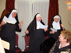 Photo: Sr. NUN FOR YOU Ann Coe, Sr. NUN OF YOUR BUSINESS Móire Stenson and Sr. NUN FOR YOU Elizabeth Hayes singing in full chorus to the delight of the choir members. Liz Dignam enjoying a close up view.