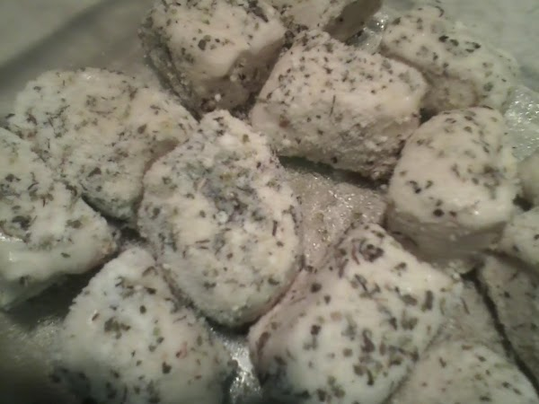 Take the cut pieces of dough and roll into the butter then the parm/herb...