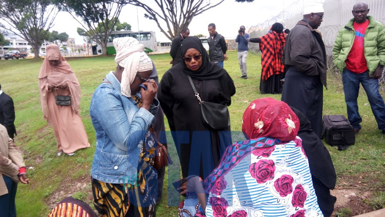 Family of the victims in a solemn mood as they await remains of the victims of the ET crash.