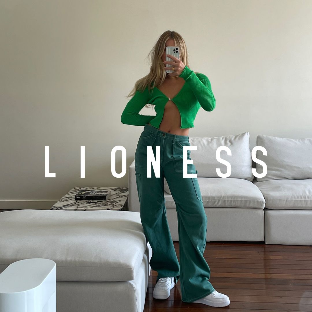 A girl poses in a green outfit with the text LIONESS superimposed over her