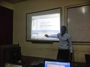 Photo: Mr. Galiwango explains the code to the class