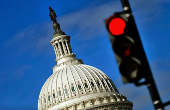 Photo: WASHINGTON, DC - SEPTEMBER 29:  A traffic light is seen in front of the United States Capitol building as Congress remains gridlocked over legislation to continue funding the federal government September 29, 2013 in Washington, DC. The House of Representatives passed a continuing resolution with language to defund U.S. President Barack Obama's national health care plan yesterday, but Senate Majority Leader Harry Reid has indicated the U.S. Senate will not consider the legislation as passed by the House.  (Photo by Win McNamee/Getty Images)