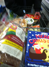 Photo: Finally to the checkout. Not too many impulse buys....the Merry Christmas Pop-Up book was a special request by my little guy.