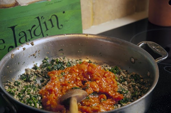 Add the marinara sauce, reduce the heat to medium low.