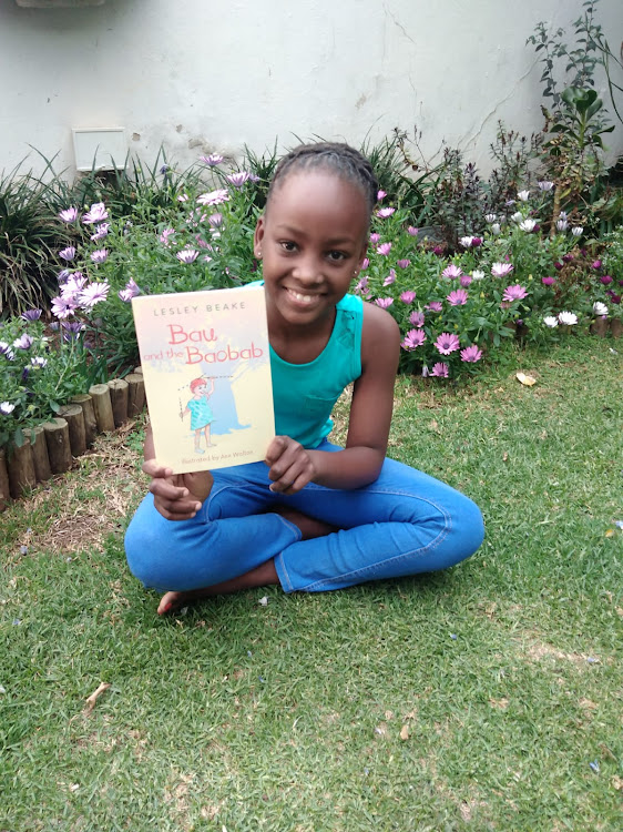Young bibliophile Nosipho Nkosi poses with 'Bau and the Baobab'.