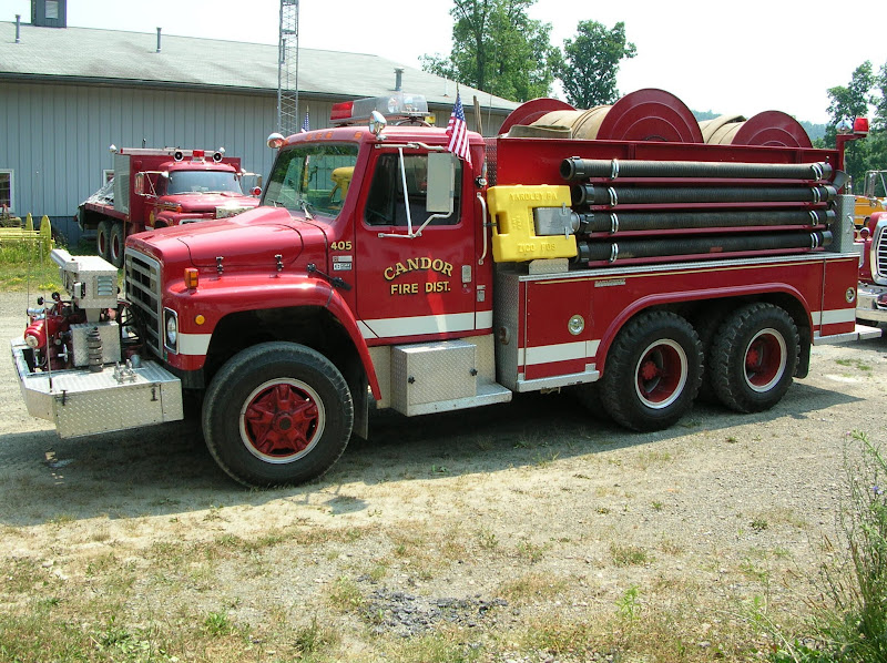"Photo: 405 - 1980 INTERNATIONAL SAL REEL TRUCK- 400 GAL.TANK & 1000 GPM FRONT MOUNT PUMP, 5,600 FEET OF 4"" HOSE ON TWO HYDRAULIC REELS"