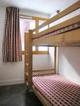 Photo: Une chambre avec lits superposés d'un appartement de la résidence