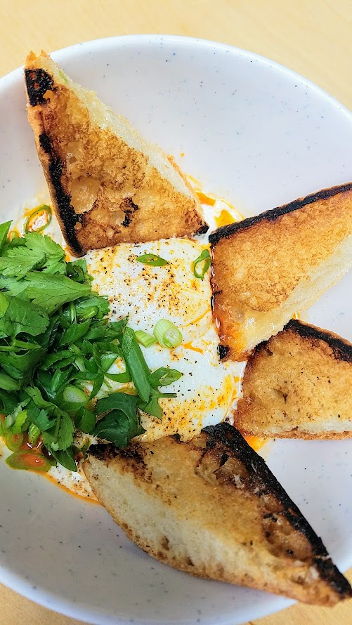 Wares PDX Brunch dish of Turkish Eggs with tahini yogurt, chorizo butter, and toast
