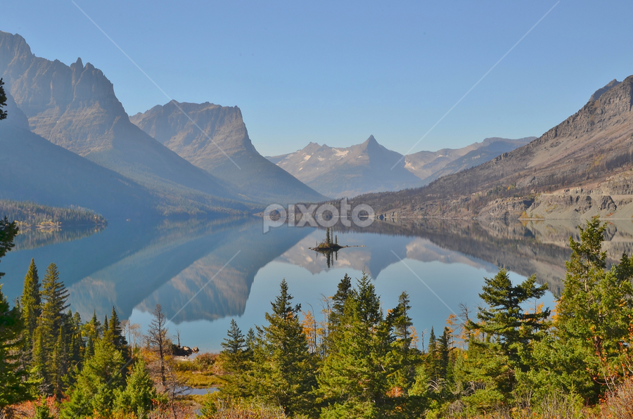Wild Goose Island by Don Evjen - Landscapes Waterscapes ( forests, pines, mountains, glacier park, montana, blue skies, lakes, reflections, blue waters, island,  )