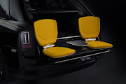 The interior theme, as well as the tailgate seats, can be ordered in this Forge Yellow.