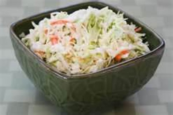 Refrigerate several hours to wilt the bagged coleslaw and to blend flavors.