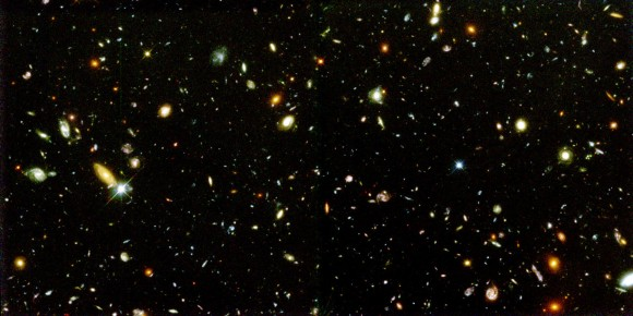 What pushes galaxies like these in the Hubble deep field apart? Image credit: NASA and A. Riess (STScI)
