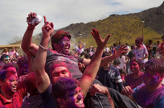 Photo: Deepak Poply, top center, is picked up by his friends during the holi festival, an annual spring Hindu festival. The event was held in Phoenix, Ariz., on Sunday. Photo by Nick Oza, The Arizona Republic.