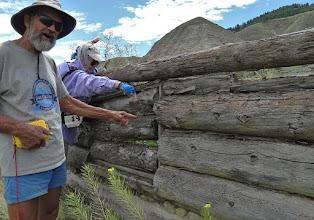 Photo: John & Peg point out old square nail.