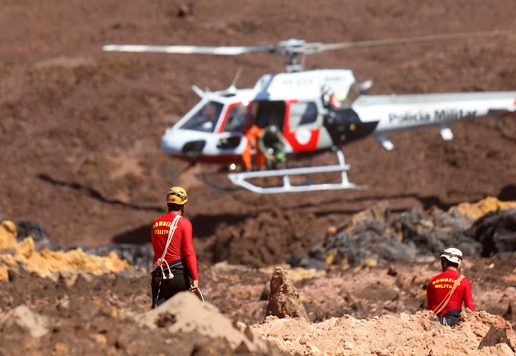 Members of a rescue team search for victims after a tailings dam owned by Brazilian mining company Vale collapsed, in Brumadinho, Brazil, January 30 2019. Picture: REUTERS/ADRIANO MACHADO