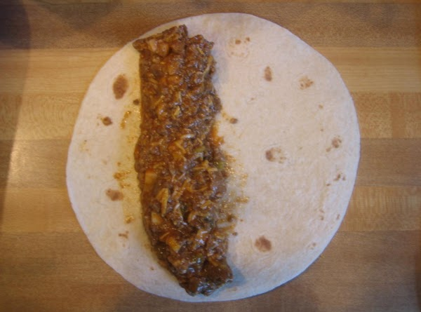 One at a time, arrange hamburger on the tortilla slightly off-center.  Roll the...