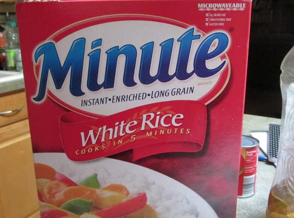 Cook Minute Rice according to package directions on box.