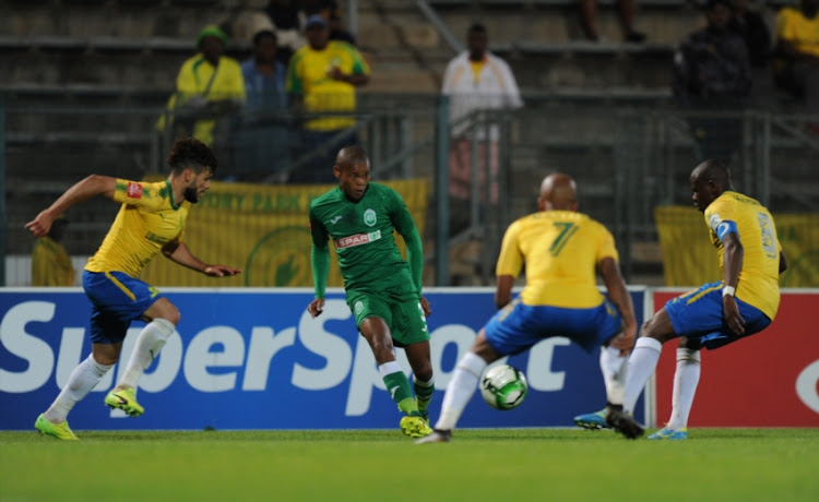 Fares Hachi,Oupa Manyisa and Hlompho Kekana of Mamelodi Sundowns in action with Lungelo Dlamini of Amazulu during the Absa Premiership match between Mamelodi Sundowns and AmaZulu FC at Lucas Masterpieces Moripe Stadium on October 21, 2017 in Pretoria, South Africa.