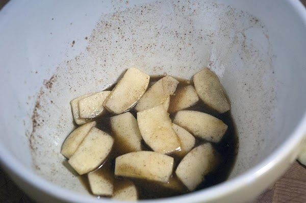 As you are slicing the apples, place them into the mixing bowl and coat...