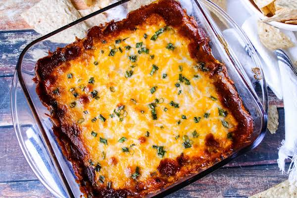 5 Layer Cream Cheese Chili Dip Baked Until The Cheese Is Gooey.