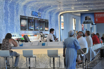 Photo: The Minnebar on Concourse G at the Minneapolis St. Paul airport offers travelers a wide array of cocktails and drinks. The space is not enclosed but is designed with tiles in shades of blue that create it's own space. It is situated just across from a new restaurant, Mimosa.  (Pioneer Press: Ginger Pinson)