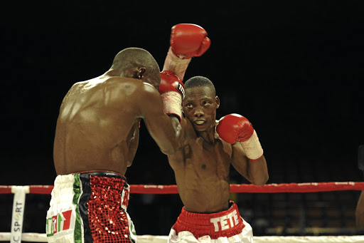 Zolani Tete, right, lashes out at Moruti Mthalane with a right during a previous fight. Tete will face Siboniso Gonya in Ireland tomorrow.