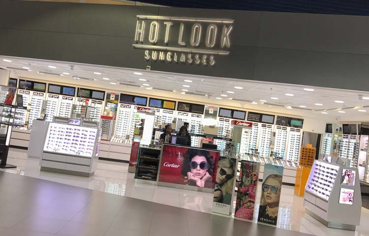 A duty-free sunglasses shop at the airport in St. Maarten: Travelers often snag a new pair of designer shades en route to a sunny destination.