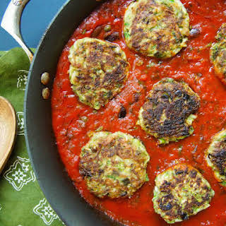 Zucchini Fritters in Tomato Olive Sauce.