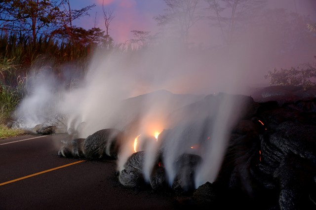Volcanic gases rise from the Kilauea lava flow that crossed Pohoiki Road near Highway 132, near Pahoa, Hawaii, U.S., May 28, 2018.