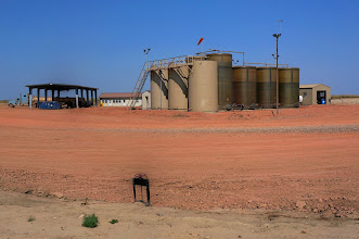 Photo: A salt water injection disposal well: During hydraulic fracturing (fracking), salt water with other chemicals is forced down into the oil/gas well in order to force up the oil. Much of this material comes back up with the oil. It is very toxic and is disposed of by reinjecting it deep underground at a facility like this.