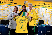 South African coach Desiree Ellis, South African captain Janine van Wyk present a jersey to Gauteng MEC for sports and recreation Mbali Hlophe during the South African national women's soccer team arrival at OR Tambo International Airport on June 19, 2019 in Johannesburg, South Africa.