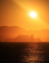 Photo: Alcatraz...the sun melts behind the desolate prison...