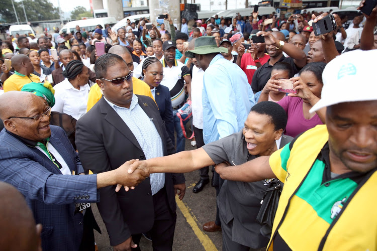 Former president Jacob Zuma greets supporters at the Pinetown taxi rank in Durban on November 16 2018.