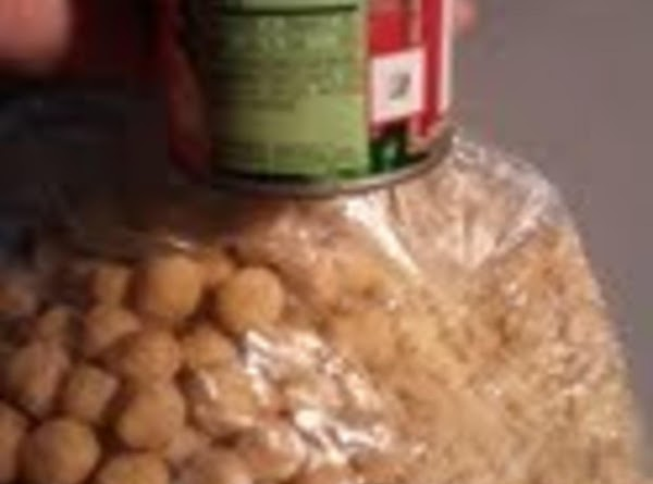 Place cereal into plastic bag and crush with can.