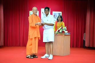 Photo: Arujun Kumanan (PSLE) receiving the Award from Swamiji