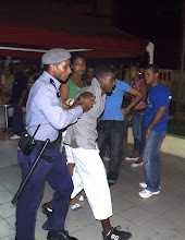 Photo: police detain a man after a scuffle in havana. Tracey Eaton photo.