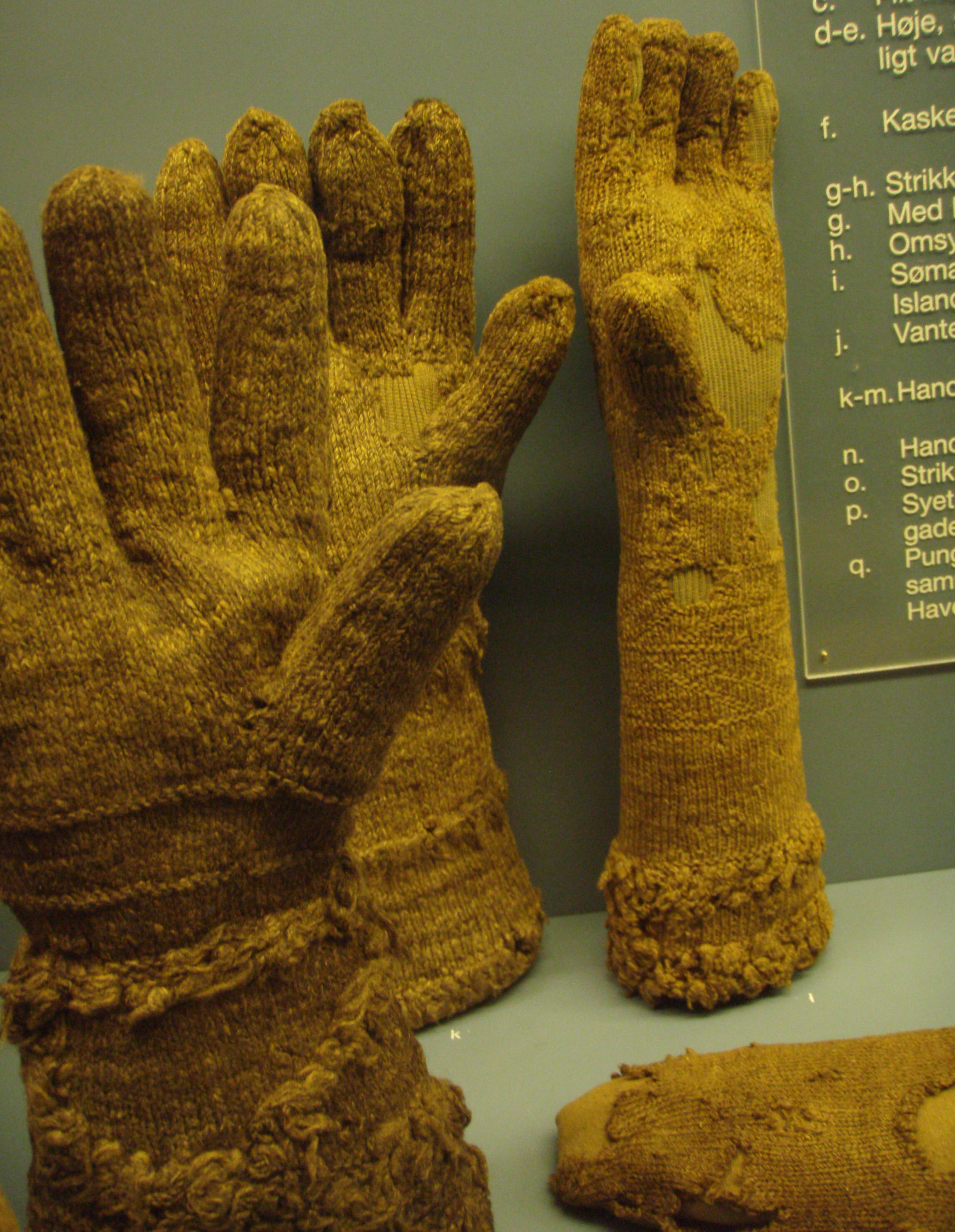 """Photo: Gloves (k,l,m): """"cuffs have stripes of imitation fur."""" Toe of stocking (o) at bottom right."""